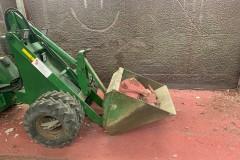 Striegl kompaktlaster.  Brukes til inn og uttrasport av masse/saget betong
